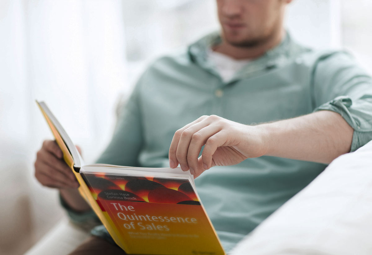 """Reader with book """"The Quintessence of Sales"""""""